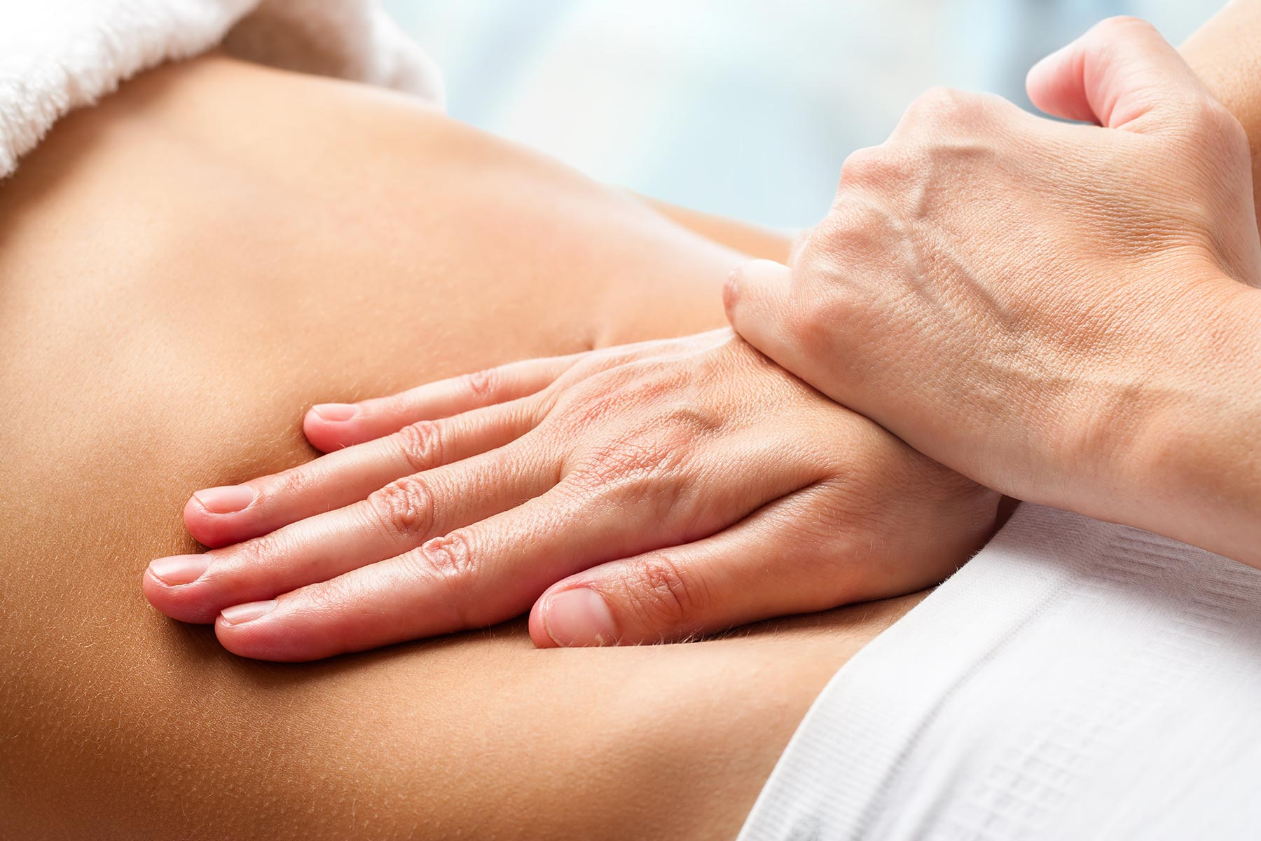 Chiropractic massage on table with towel